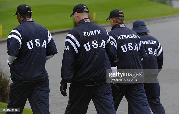 US Ryder Cup players Tiger Woods Jim Furyk Steve Stricker and Rickie Fowler walk together through the rain during a practice session at Celtic Manor...
