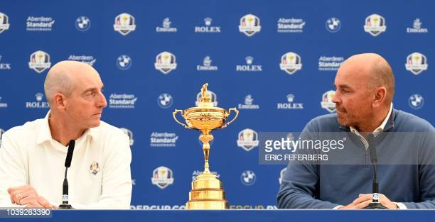 Ryder Cup team captains Europe's Thomas Bjorn and US Jim Furyk attend a press conference ahead of the 42nd Ryder Cup at Le Golf National Course in...