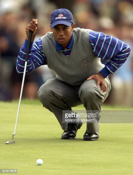 Ryder Cup team member Tiger Woods studies his putt during his Four-Ball match 17 September, 2004 at Oakland Hills Country Club in Bloomfield...