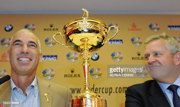 Ryder Cup US team captain Corey Pavin answers a question from the media alongside European team captain Colin Montgomerie during a press conference...