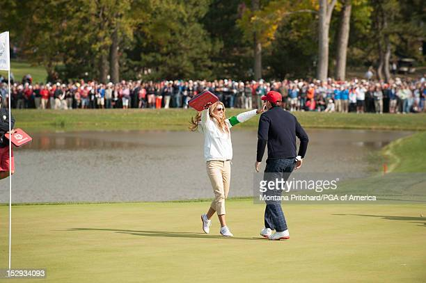 Ryder Cup US team member Keegan Bradley hugs his girlfriend Jillian Stacey after a 4/3 on the 15th hole during the Morning Foursome Matches for the...