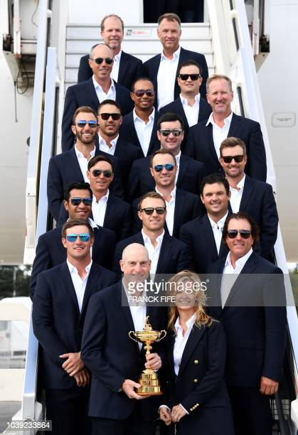 Ryder cup US team members pose as they arrive at Paris Charles de Gaulle airport in Roissy on September 24 2018 ahaed of the 42nd Golf Ryder Cup