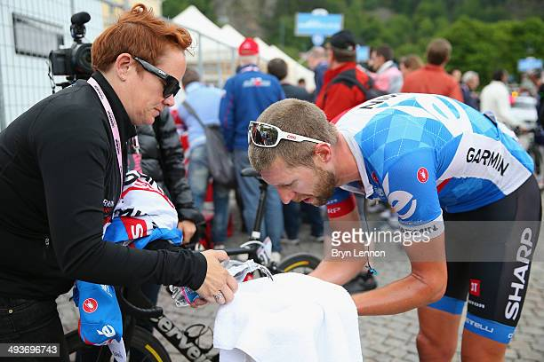 Ryder Hesjedal of Canada and Garmin-Sharp cleans himself after the fourteenth stage of the 2014 Giro d'Italia, a 164km high mountain stage between...