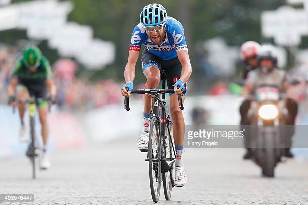 Ryder Hesjedal of Canada and team Garmin-Sharp crosses the finish line during the fourteenth stage of the 2014 Giro d'Italia, a 164km high mountain...