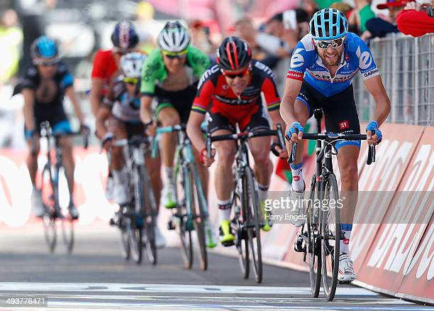 Ryder Hesjedal of Canada and team Garmin-Sharp crosses the finish line during the fifteenth stage of the 2014 Giro d'Italia, a 225km high mountain...