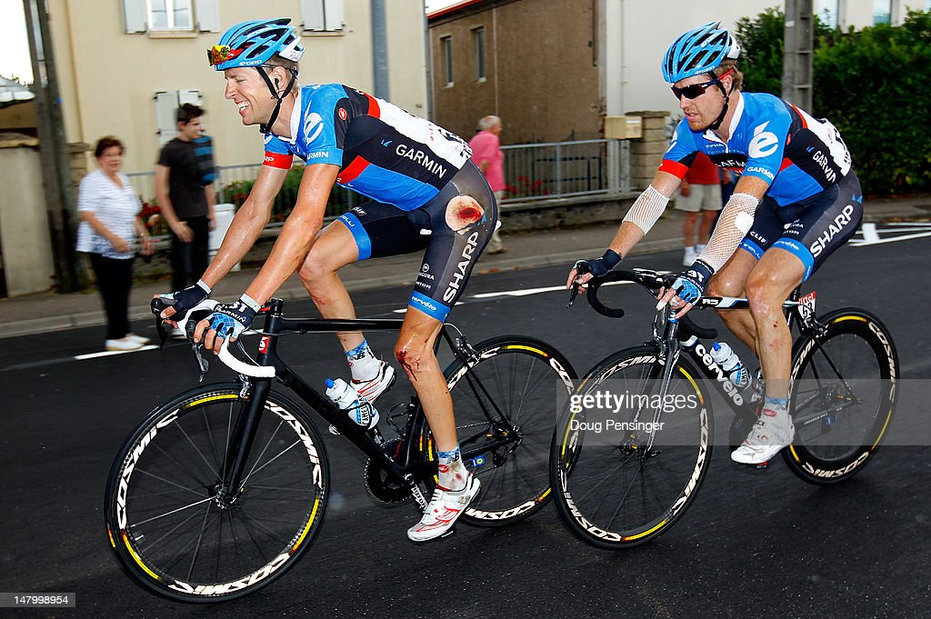 Ryder Hesjedal of Canada riding for Garmin-Sharp is accompanied by teammate Tyler Farrar of the USA as they ride to the finish of stage six of the 2012 Tour de France from Epernay to Metz on July 6, 2012 in Metz, France. Hesjedal was involved in a crash 25km from the end of the stage and was seperated from the group of the yellow jersey.