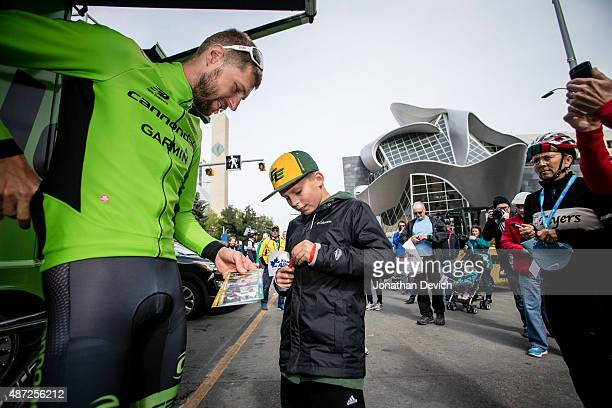 Ryder Hesjedal riding for the Cannondale-Garmin Pro Cycling Team signs an autograph before the start of stage 6 of the Tour of Alberta on September...