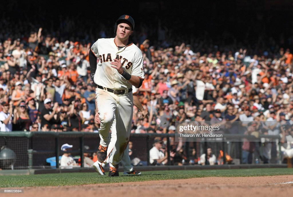 Ryder Jones #63 of the San Francisco Giants scores against the San Diego Padres in the bottom of the seventh inning at AT&T Park on September 30, 2017 in San Francisco, California.