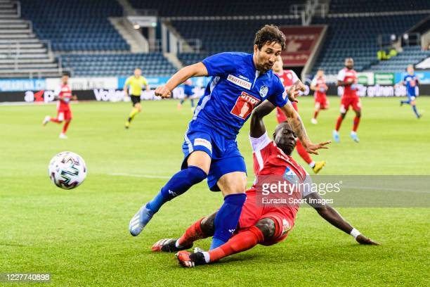Ryder Matos of Luzern is challenged by Birama Ndoye of FC Sion during the Swiss Raiffeisen Super League match between FC Luzern and FC Sion at...