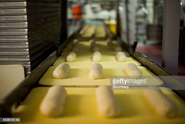 Rye bread dough move towards the oven at the Orlando Baking Co in Cleveland Ohio US on Wednesday Aug 13 2014 Wheat rose after the US lifted the...