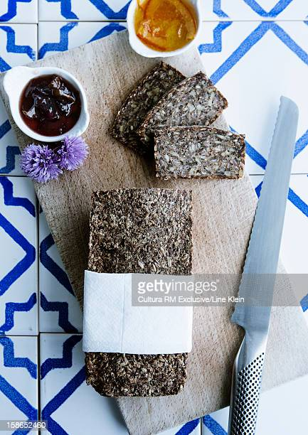 Rye bread with jams on cutting board