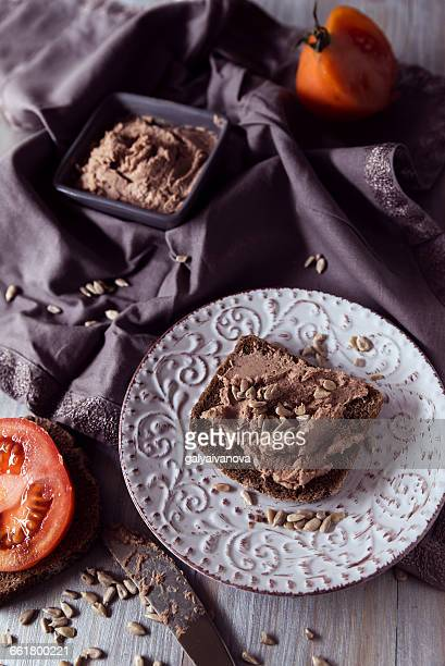 Rye bread with liver pate, tomato and sunflower seeds