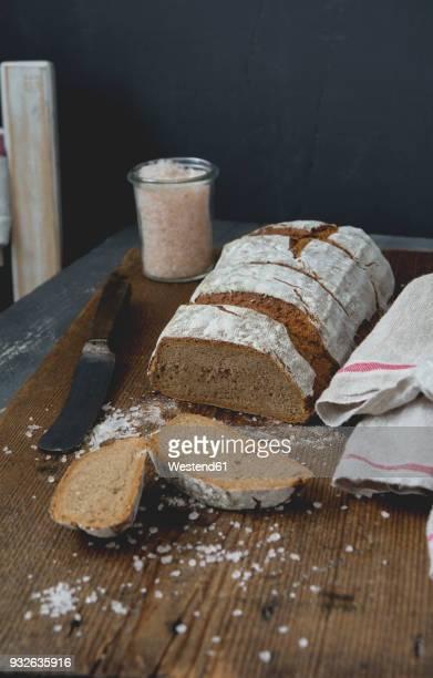 Rye bread with salt on chopping board