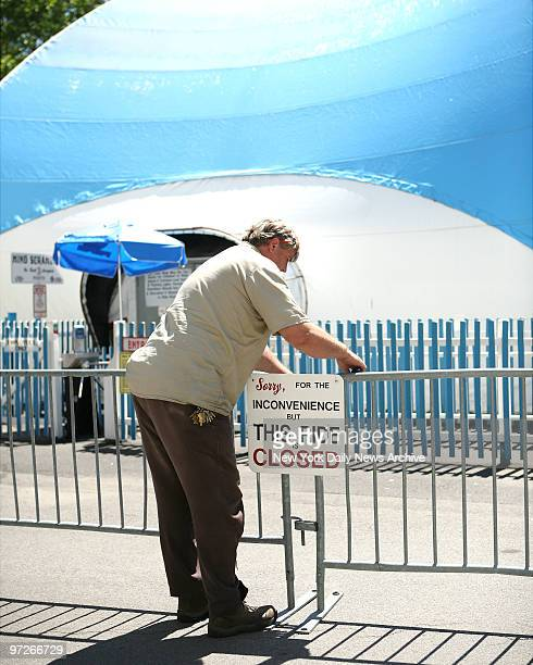 Rye Playland worker puts up closed sign on the Mind Scrambler where Gabriella Garin was killed last night in Rye Playland Rye New York Garin worked...