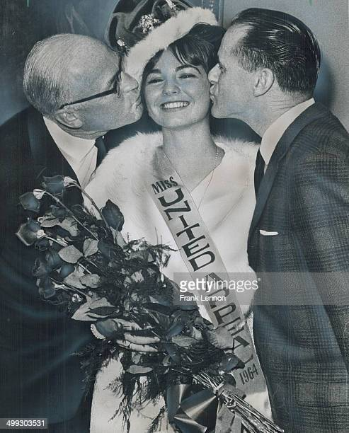Ryerson student Margo Gibson 18; gets kisses from United Appeal chairman William Mitchell and her father; William; after winning the Miss United...
