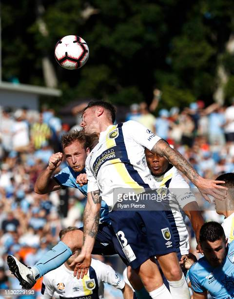 Ryhan Grant of Sydney FC competes for the ball against Aiden O'Neill of the Mariners during the round 19 ALeague match between Sydney FC and the...