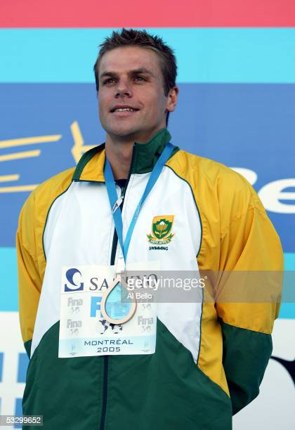 Ryk Neethling of South Africa smiles on the podium after receiving the bronze medal in the 100 meter Freestyle final during the XI FINA World...