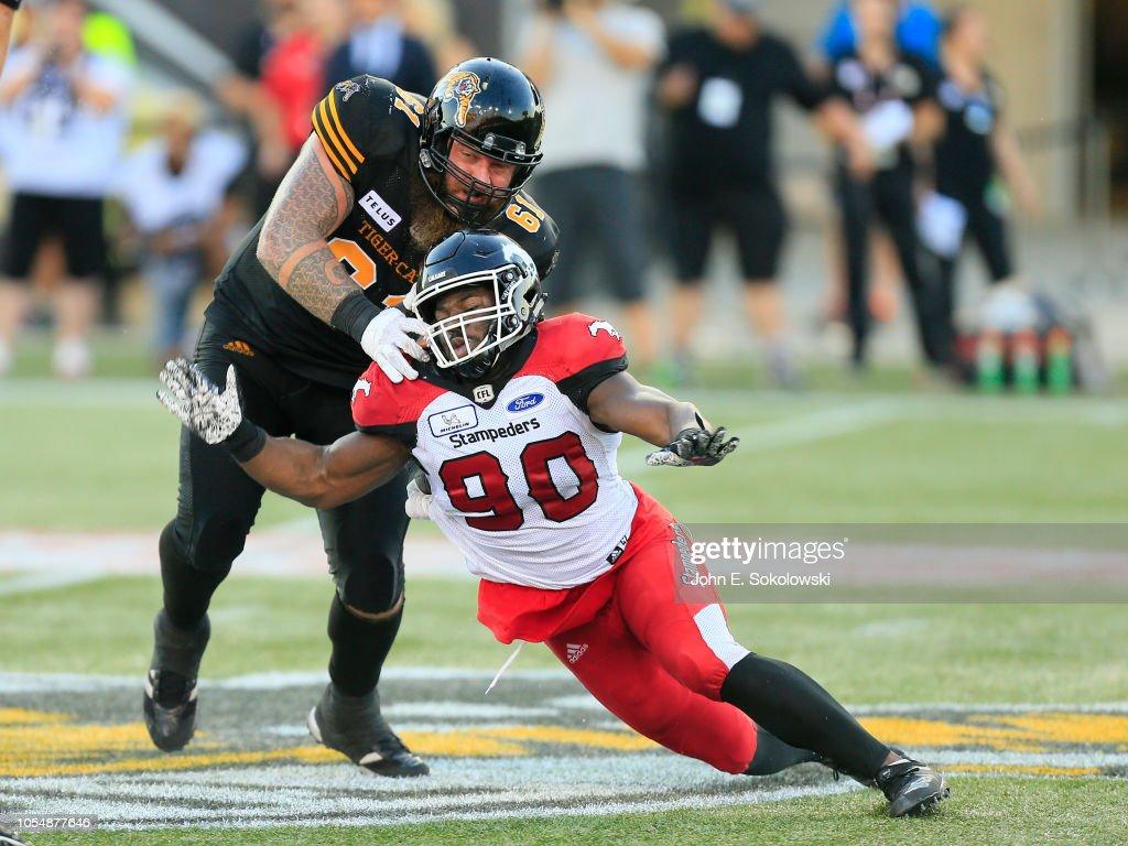 Ryker Mathews of the Hamilton Tiger-Cats blocks against Calgary ... 40088a17f
