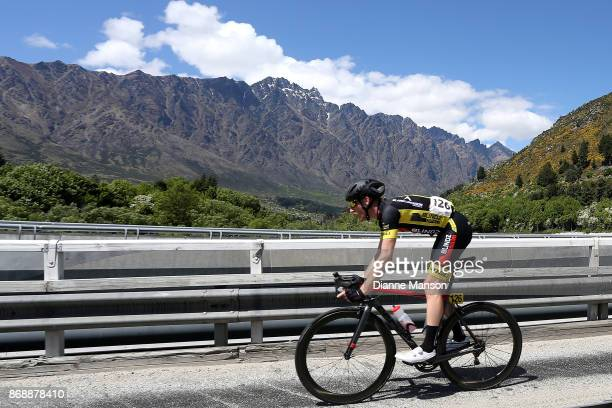 Rylan Dowdell of Australia Blindz Direct makes this way over the bridge towards Frankton passing the Remarkables during stage 3 from Mossburn to...
