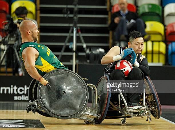 Ryley Batt of Australia and Hidefumi Wakayama of Japan clash during the 2015 BT World Wheelchair Rugby Challenge match between Australia and Japan at...