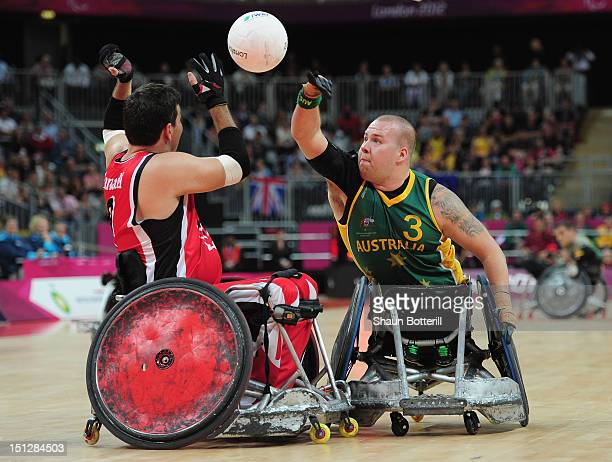 Ryley Batt of Australia challenges Mike Whitehead of Canada to the ball during the Wheelchair Rugby match between Australia and Canada on day 7 of...