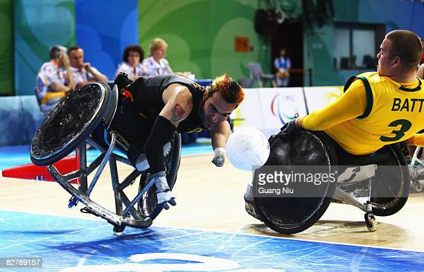 Ryley Batt of Australia hits Salih Koeseoglu of Germany in the Wheelchair Rugby match between Australia and Germany at Beijing Science and Technology...