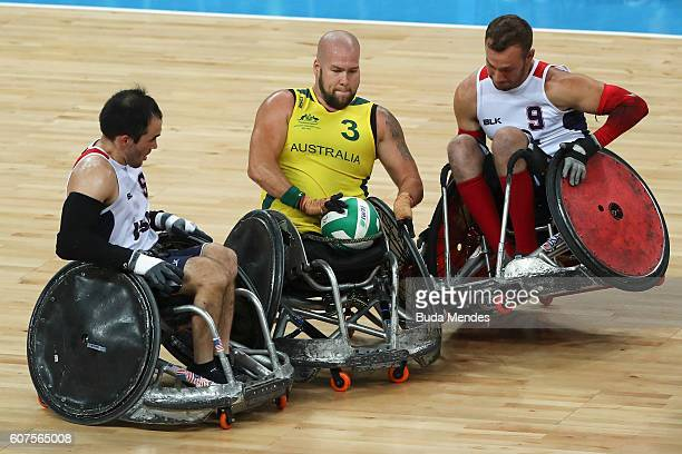 Ryley Batt of Australia in action against Chuck Aoki and Eric Newby of the United States during the Men's Wheelchair Rugby Gold Medal match between...