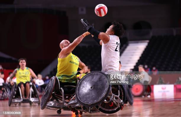 Ryley Batt of Team Australia competes for the ball with Yukinobu Ike of Team Japan in the first half during the bronze medal wheelchair rugby match...