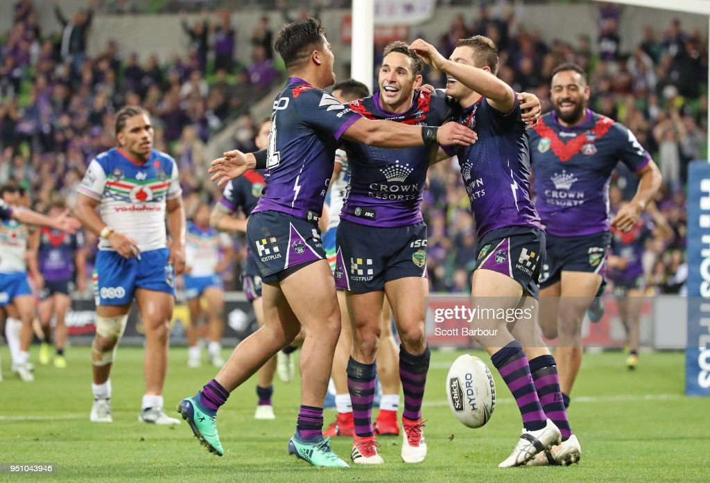 Ryley Jacks of the Melbourne Storm is congratulated by Billy Slater and his teammates after scoring a try during the round eight NRL match between the Melbourne Storm and New Zealand Warriors at AAMI Park on April 25, 2018 in Melbourne, Australia.