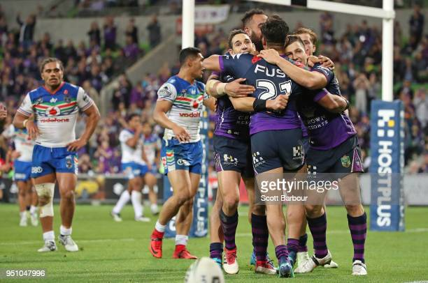 Ryley Jacks of the Melbourne Storm is congratulated by Billy Slater and his teammates after scoring a try during the round eight NRL match between...