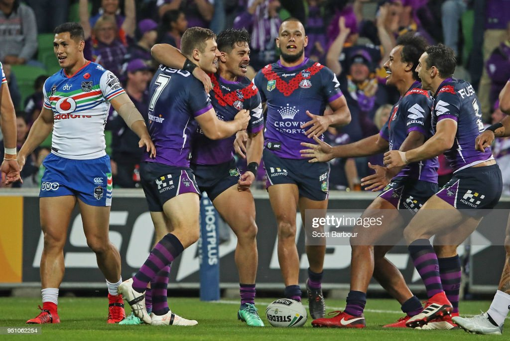 Ryley Jacks of the Melbourne Storm is congratulated by his Billy Slater of the Melbourne Storm and his teammates after scoring the first try during the round eight NRL match between the Melbourne Storm and New Zealand Warriors at AAMI Park on April 25, 2018 in Melbourne, Australia.