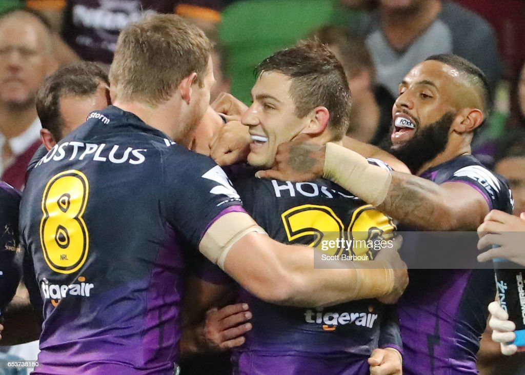 Ryley Jacks of the Melbourne Storm is congratulated by his teammates after scoring a try during the round three NRL match between the Melbourne Storm and the Brisbane Broncos at AAMI Park on March 16, 2017 in Melbourne, Australia.