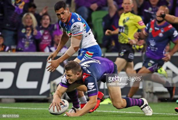 Ryley Jacks of the Melbourne Storm scores the first try during the round eight NRL match between the Melbourne Storm and New Zealand Warriors at AAMI...