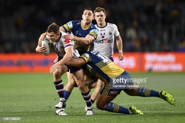 Ryley Jacks of the Storm is tackled during the round 15 NRL match between the Parramatta Eels and the Melbourne Storm at Bankwest Stadium on August...