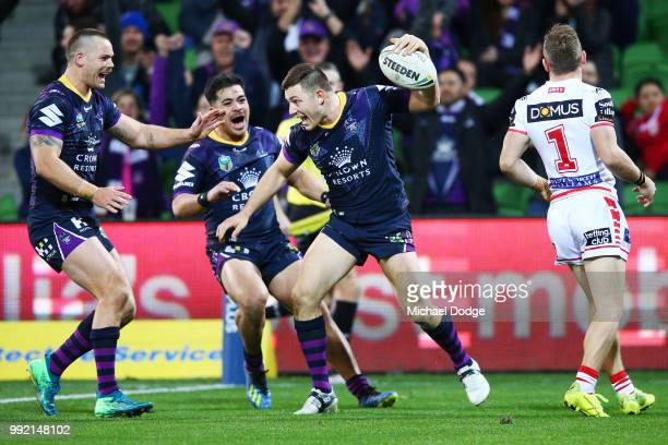 Ryley Jacks of the Storm scores a try during the round 17 NRL match between the Melbourne Storm and the St George Illawarra Dragons at AAMI Park on...