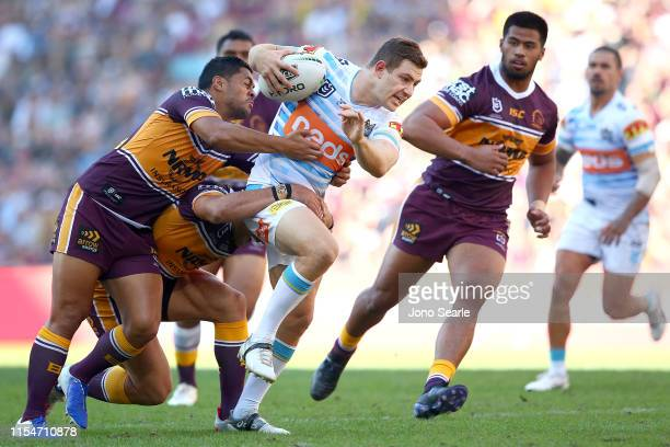 Ryley Jacks of the Titans tries to break free during the round 13 NRL match between the Brisbane Broncos and the Gold Coast Titans at Suncorp Stadium...