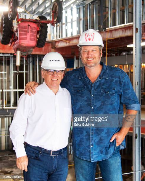 Ryman Hospitality Properties' chairman and CEO Colin Reed poses for a photo with country artist and Opry member Blake Shelton during a hard hat tour...