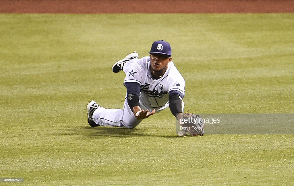 Rymer Liriano #7 of the San Diego Padres can't make a diving catch on a single hit by Justin Morneau #33 of the Colorado Rockies during the third inning of a baseball game at Petco Park August, 11, 2014 in San Diego, California.