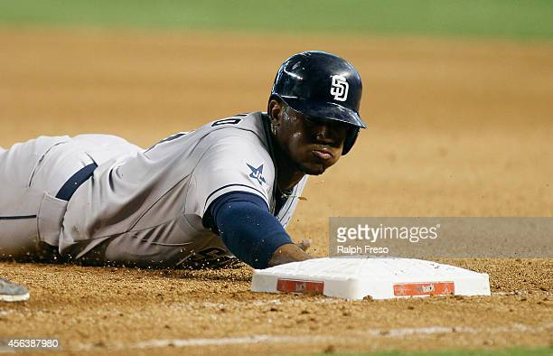 Rymer Liriano of the San Diego Padres dives back to first base during the seventh inning of a MLB game against the Arizona Diamondbacks at Chase...