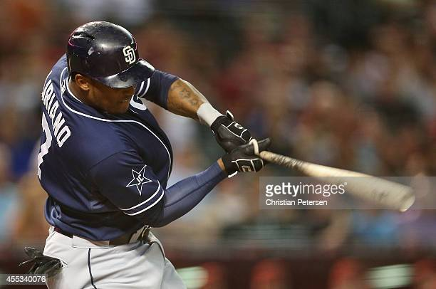 Rymer Liriano of the San Diego Padres hits a RBI on a fielder's choice during the second inning of the MLB game against the Arizona Diamondbacks at...