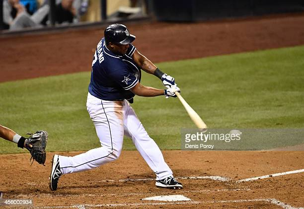 Rymer Liriano of the San Diego Padres hits an RBI single during the sixth inning of a baseball game against the Colorado Rockies at Petco Park...