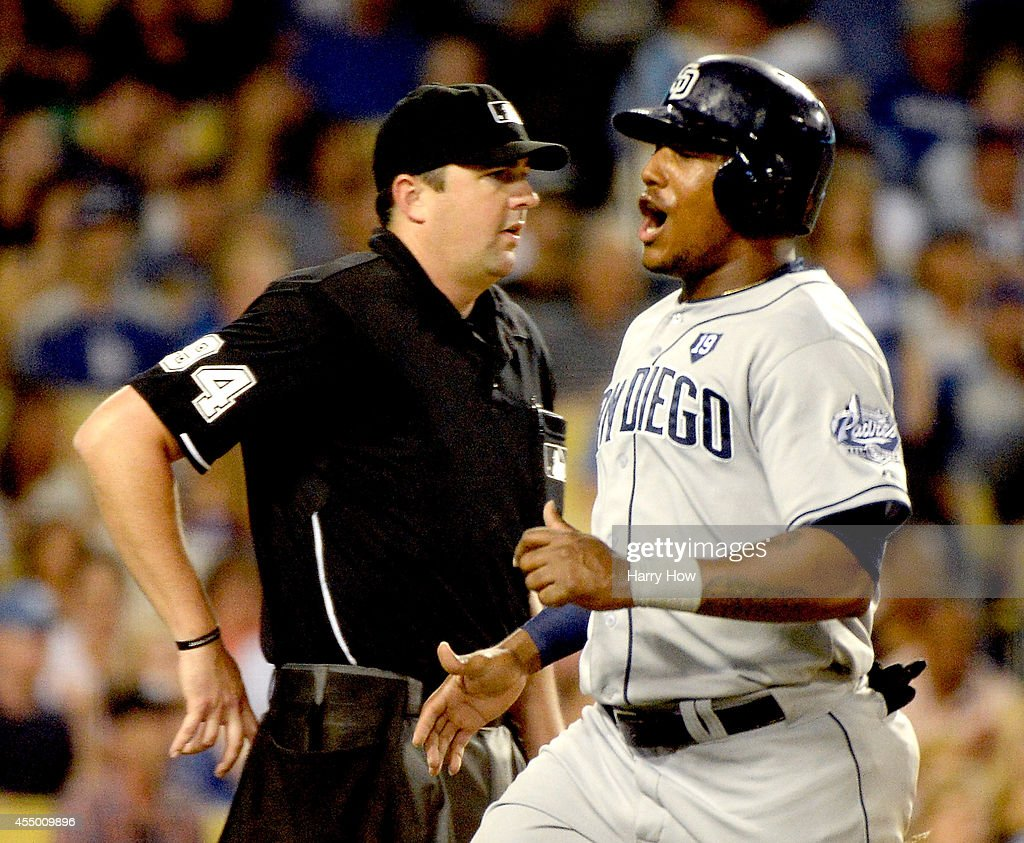 Rymer Liriano #7 of the San Diego Padres reacts to his run in front of umpire Lance Barrett to trail 2-1 to the Los Angeles Dodgers during the fourth inning at Dodger Stadium on September 8, 2014 in Los Angeles, California.