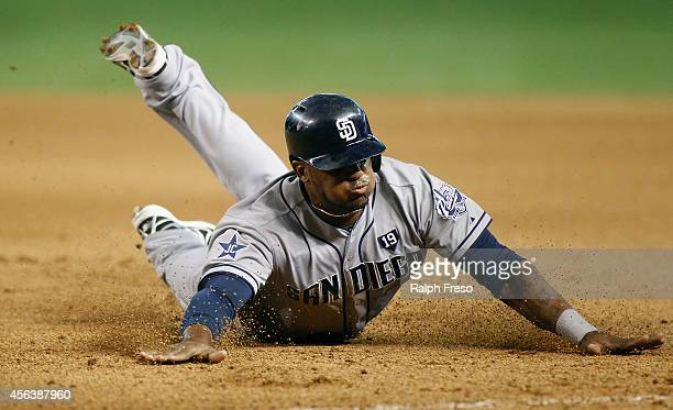 Rymer Liriano of the San Diego Padres slides head first back to first base during the seventh inning of a MLB game against the Arizona Diamondbacks...