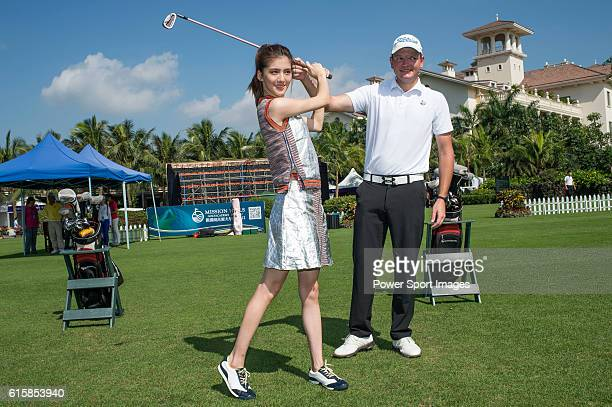 Rynard van Eden of South Africa gives a clinic to golfers including Hong Kong model Karena Ng on the sidelines of World Celebrity ProAm 2016 Mission...