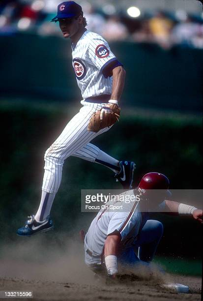 Ryne Sandberg of the Chicago Cubs gets the putout on John Kruk of the Philadelphia Phillies during a MLB baseball game circa 1990 at Wrigley Field in...