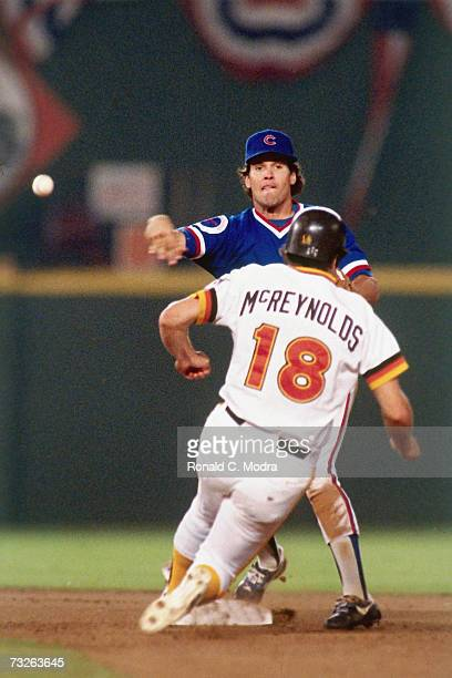 Ryne Sandberg of the Chicago Cubs throws to first base as he forces out Kevin McReynolds of the San Diego Padres in the National League Championship...