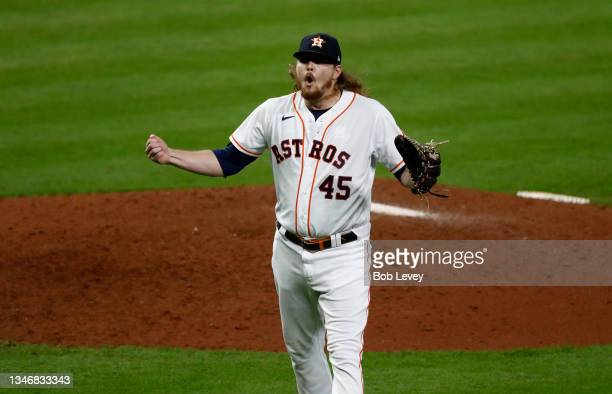 Ryne Stanek of the Houston Astros reacts after the final out of the seventh inning against the Boston Red Sox during Game One of the American League...