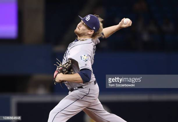 Dwight Smith Jr #27 of the Toronto Blue Jays hits a double in the ninth inning during MLB game action against the Tampa Bay Rays at Rogers Centre on...