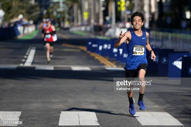 Ryo Furukawa crosses the finish line of the 2020 Los Angeles Marathon on March 08 2020 in Los Angeles California