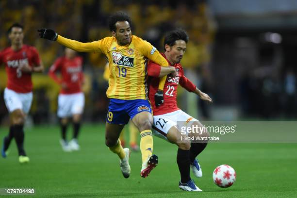 Ryo Germain of Vegalta Sendai and Yuki Abe of Urawa Red Diamonds compete for the ball during the 98th Emperor's Cup Final between Urawa Red Diamonds...